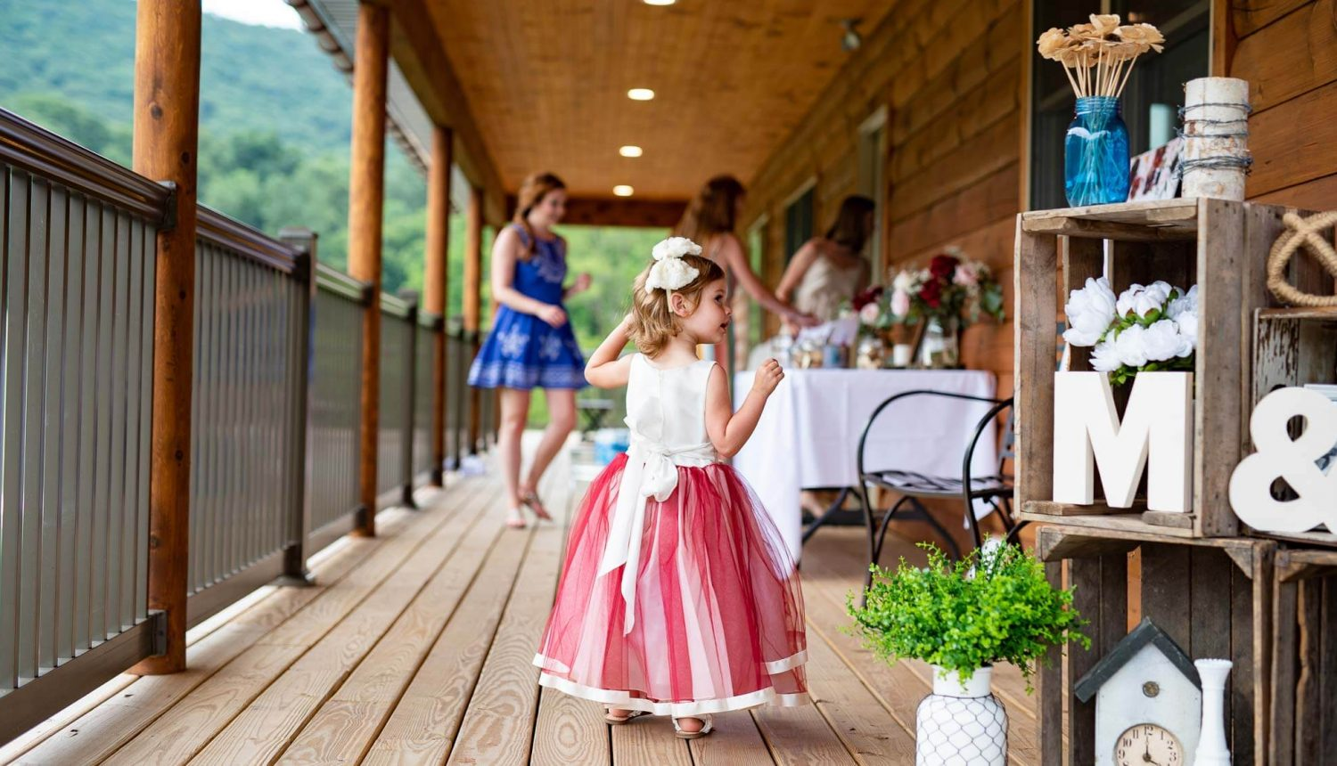 Flower girl on the porch at Fox Run Retreat
